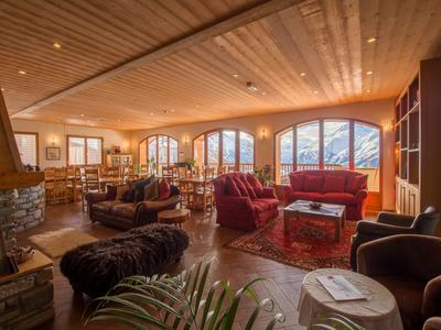 Exceptional luxury ski chalet in La Rosière with 10 en suite bedrooms accommodating up to 28 people, wood burner, spa with sauna and inside and outside hot pools, and breathtaking views overlooking the mountain tops of the Haute Tarentaise.