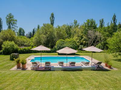 Picturesque property comprising main house with 3 apartments and an independent  guest house, set in 4 acres of enchanting gardens with a mill stream, and in easy walking distance of Le Bugue.