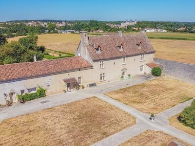 Enchanting XVIth century chateau for sale. Manor house with paddocks, stables, 2 gites and pool.  A romantic stylish historic home perfect for equestrian activity.