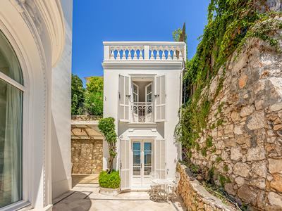 A majestic, Belle Epoque villa commanding simply stunning views across the Rade de Villefranche, Cap Ferrat and Villefranche old town, with four beautiful bedrooms and two separate guest houses, large swimming pool and around 300m2 of exquisite living space