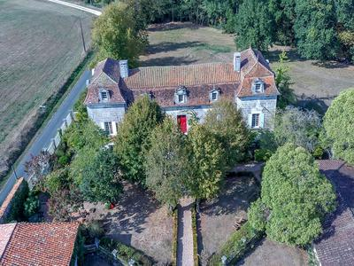Magnificent chartreuse with gite and barns set in 7 hectares of parkland with pool and 2 small lakes
