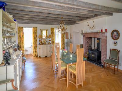 Elegant, manor house tastefully decorated throughout, set in over 3 hectaires with country views and numerous outbuildings.