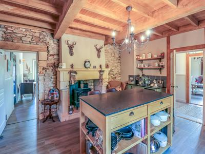 Beautifully refurbished to a very high standard, this property consists of Maison de Maître with 5 bedrooms (3 currently used as B&B), gîte with 3 bedrooms, large pool and many outbuildings for further development.