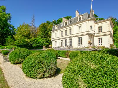 Chateau Quantilly dating from 1830 renovated to a high standard with 14 hectares 35.5 acres of park and woodland a 3 bedroom caretakers house garages and swimming pool magnificent views situated 2h.20 minutes south of Paris in the Cher dept 18.