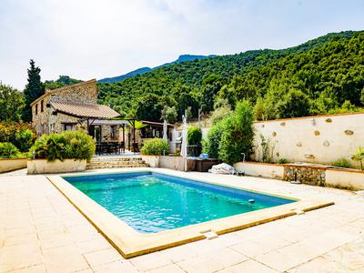 Beautifully restored CATALAN STONE MAS dating from 1900's, offering spectacular views from Canigou to Mediterranean Coast.  Located in the heights of LAROQUE DES ALBERES