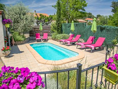 Luxurious living in this strikingly exquisite 380m2 three-story, historic Maison de Maître located in the heart of the Minervois valley and primed with 7 bedrooms, 6 bathrooms, and a peaceful, backyard paradise with a spectacular swimming pool.
