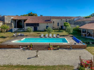 Wonderful, fully renovated Manoir, on edge of a small Pretty Village. 6 bedrooms, Pool, Tennis Court. Over 3 acres of garden. Cognac 20 mins. Angouleme 20 mins