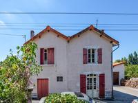 Maison de village avec 3 chambres, jardin, hangar, garage.
