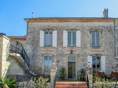 Beautiful maison de maitre dating from 1890 and adjoining old boulangerie, glazed poolhouse and garden.