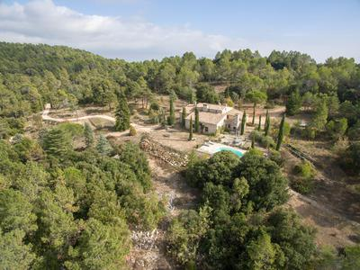 St Cezaire sur Siagne/Cabris. Secluded private estate of 20 acres, including a classic Provencal style, 7 bedroomed stone built country house and swimming pool.