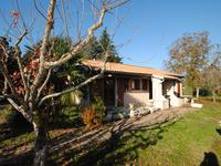 Jolie maison en plain-pieds - 3 chambres - avec véranda et garage, jardin facile à entretenir.Proche de Saint-Emilion!