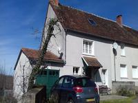 Ravissante maison de village de 3 chambres avec un garage et jardin.