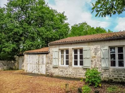 Stunning, detached, stone built Logis, with second, detached, house, two garages & outbuildings. Woodland, secret courtyard, gardens and pool.  Between Jarnac and Chateauneuf.