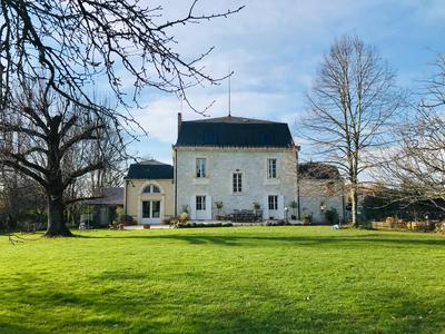 A beautifully proportioned maison de maître with annex in village with shops and restaurants close to Ste Foy la Grande and 30mns to Bergerac