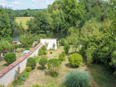 Main house and gite, used for chambre d'hôtes. Garden leading to the river Charente