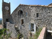 Maison de village en pierre avec jardin privé et vues dans un charmant village médiéval.