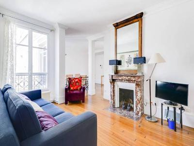 PARIS 75004, on Rue des Francs-Bourgeois in the heart of Paris' 4th arrondissement, is this delightful 72m2 fifth floor apartment - in a 17th century building with an elevator - consisting of two bedrooms, classic characteristics and a prestigious address. A prime piece of property in a desirable neighbourhood, great for a couple or those frequenting the city of lights.