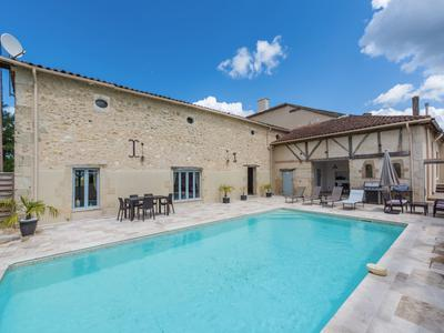 Beautiful 4 bedroom Manoir with 2 adjoining houses one with 4 bedrooms and the other with 3 bedrooms, pool. Renovated in exquisite taste, tranquil location, set in over 4 Hectares of land, with lovely views, easily accessible from Bordeaux.