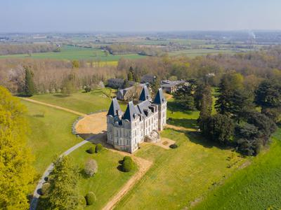 Stately 16th century Anjou Château set in 68 acre grounds, with substantial outbuildings, offering a family home with business potential.