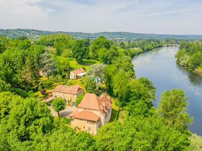No expense spared on this exquisite and historic property circa 1640 with infinity pool situated high above the Dordogne river in a world of its own