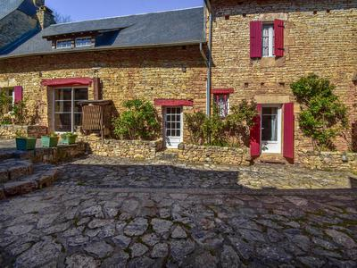A rare opportunity to purchase a  spacious gite complex catering for large groups (55 people) in scenic part of (Perigord Noir) Dordogne with,heated   swimming pool, spa, tennis and private restaurant/bbq area .