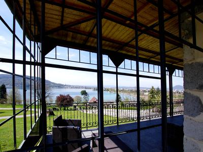 Striking 19th century manor house set within 1.2 acres of pasture with exceptional views of lake Annecy and the city