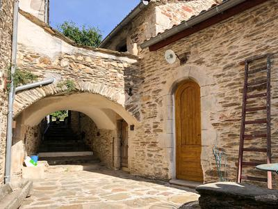Beautifully renovated large 17th century stone house, stunning interior design, lovely views, in a small hamlet in the Cévennes, infinity pool, stream and town water, superbly designed outdoor space, possibility for use as chambres d'hotes, yoga sanctuary, or large family home. Nimes 36 miles, Alès 10 miles
