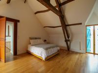 Spacious living areas with lots of character beams