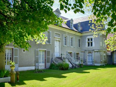 "Magnificent 12-bedroom Maison de Maitre ""Le Chateau"" in over 9 hectares of parkland, woodland and pastureland close to skiing, walking and cycling.  Includes a gite, 4-bedroom home and a number of outbuildings"