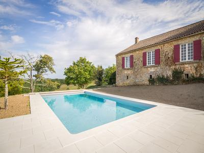 Imposing 18th century property surrounded by 66 acres of forest and meadow with beautiful views of the Perigord Noir country side.