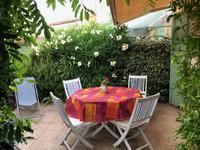 Pavillon en résidence avec terrasse et jardinet privatifs et une place de parking